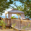 Pavilion in natural style on a beach. — Stock Photo