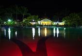 Pavilion with night illumination behind pool — Stock Photo