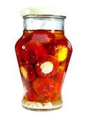 Marinaded tomatoes in a glass jar, stuffed — Stock Photo