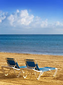 Chaise lounges on a beach. — Stock Photo