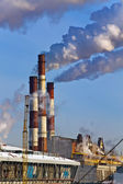 Thermal power station pipes smoke over a city. — Stock Photo