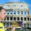 Royalty-Free Stock Photo: Italy. Rome. The man artist draws the Colosseum.