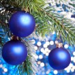 Royalty-Free Stock Photo: Dark blue New Year's balls on a snow-covered branch
