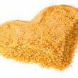 Heart from not refined reed granulated sugar — Stock Photo #14857857