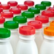 Numbers of milk bottles — Stock Photo