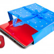 Red notebook and a computer mouse are packed into a gift packet by New year — Stock Photo