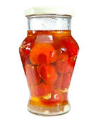 Canned tomatoes in glass jars — Stock Photo
