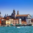 Grand Canal with boats and Basilica Santa Maria della Salute, Venice, Italy - Stock Photo