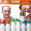 Royalty-Free Stock Photo: Men selects dairy products in the shop