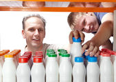 Men selects dairy products in the shop — Stock Photo