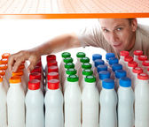The man selects dairy products in the shop — Stock Photo