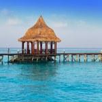 Island in ocean, arbor over water for rest — Stock Photo #19132495