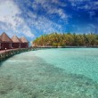 Island in ocean, overwater villas — Stock Photo