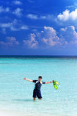 Man in the sea with the equipment for a snorkeling — Stock Photo
