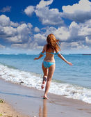 The young attractive woman on the sea coast — Stock Photo