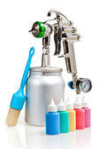 New metal brilliant Spray gun and small bottles with color — Stock Photo