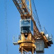 The building crane during an operating time - Stock Photo