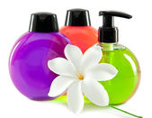 Bright color cosmetic small bottles with the dispenser — Stock Photo