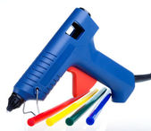 Intsrument for repair and design works - the glutinous gun and color cores — Stock Photo