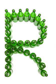 The alphabet from glass beer bottles. Letter R — Stock Photo