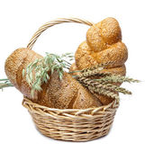 Basket with bread on white background — Stock Photo