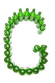 The alphabet from glass beer bottles. Letter G — Stock Photo
