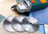 The cutting machine and various detachable disks — Stock Photo