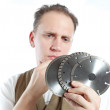 Stock Photo: Man, builder, chooses detachable disk for tool