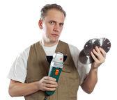 Muž, stavitel, zvolí bimetalické pro nástroj — Stock fotografie