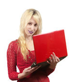 The young beautiful woman in red blouse with the red laptop — Stock Photo