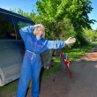 Womin working overalls tries to replace wheel at off-road car — Stock Photo #24480701