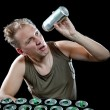 Hangover. The man examines, whether there is no beer drop in a can — Stock Photo