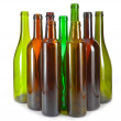 Bright colorful wine bottles and glass — Stock Photo