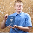 Stock Photo: Schoolboy with certificate about completion of education at school..