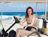 Women by golf car on the seashore. Mexico. Women Island — Stock Photo