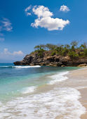 View from a sandy beach on rocks at ocean. Indonesia, Bali — Stock Photo