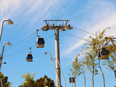 Teleferics (overhead cable cars) over Barcelona, Spain. Cable way at Monjuic hill — Stockfoto