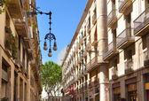 The narrow street with old houses. Barcelona. Spain. — Stock Photo