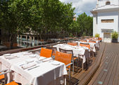 Tables at the summer outside dining area of the restaurant in Barcelona — Stock Photo