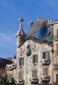 A famous tourist destination restored by catalan architect Antoni Gaudi. Facade is decorated with mosaic tiles — Stock Photo