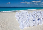 Chairs and tables waiting Wedding on tropical beach. — Stock Photo