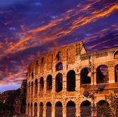Bright crimson sunset over the ancient Colosseum. Rome. Italy — Stock Photo