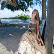 Stock Photo: Young womin long sundress on tropical beach. Polynesia. Island