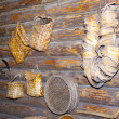 Open-air museum of ancient wooden architecture, Wattled products from a rod on a wall. Vitoslavlitsy, Great Novgorod — Stock Photo #29007823