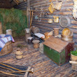 Open-air museum of ancient wooden architecture, log hut interior. Vitoslavlitsy, Great Novgorod — Stock Photo #29013635