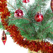 New Year's balls on branches of a Christmas tree and gifts — Stock Photo