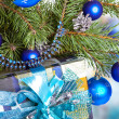 New Year's balls on branches of a Christmas tree and gifts — Foto de Stock