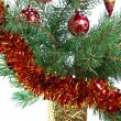 New Year's balls on branches of a Christmas tree and gifts — 图库照片