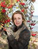 The young woman near red berries of a ripe mountain ash — Stock Photo