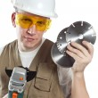 The man in working overalls in goggles and a helmet — Stock Photo #31947827